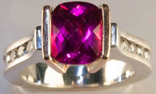 Previously owned Tourmaline diamond 14K ring. .