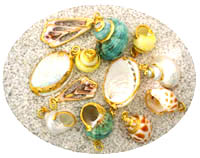 Samples of Gold Trimmed Seashells.  Select from these items featured here, plus many other unique styles to choose from in our Newport, Oregon showroom.  We are open Monday through Saturday 10:00 a.m. to 5:00 p.m. year round, for your shopping pleasure!